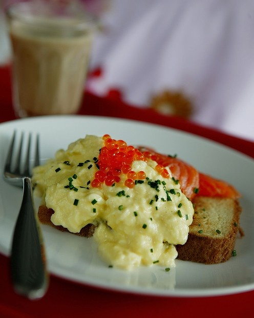 Scrambled eggs with chopped chives and salmon caviar. The best breakfast.