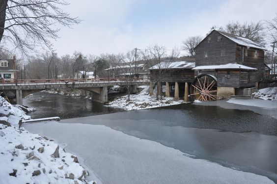 The Old Mill covered in winter snow. We love this restaurant in Pigeon Forge!