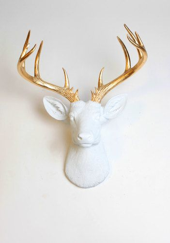 The extra large Alfred white w/ gold antlers faux deer head wall mount. Made of a plastic resin stag animal head decor and wall art by White Faux Taxidermy.