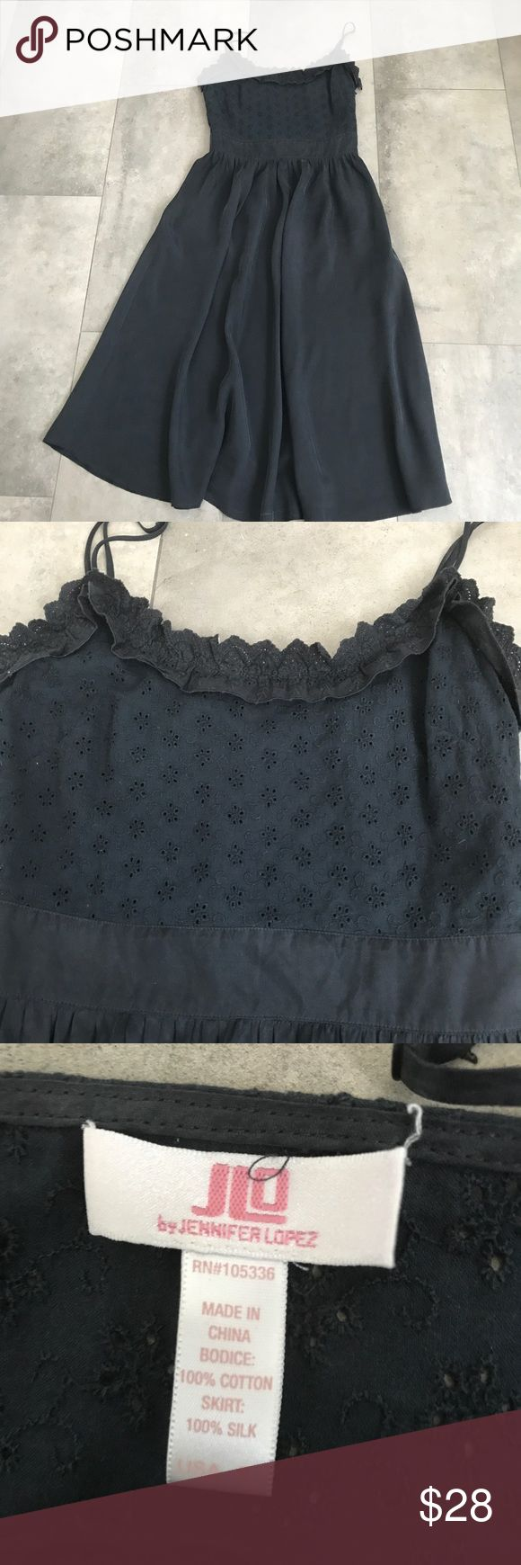 {jlo by Jennifer Lopez} black midi dress! Jlo by Jennifer Lopez black eyelet silk dress! Size small. Pre loved but in good condition! Adjustable straps. Bodice is 100% cotton, skirt part is 100% silk. Waist flat is 13.5 in, length from mid back is 40 in. Bundle and save! Jennifer Lopez Dresses Midi