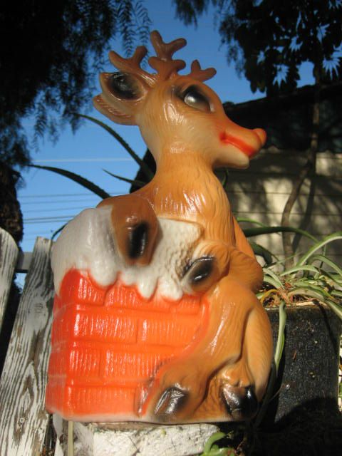 Vintage Christmas Blow Mold ~ Rudolph Clinging To The Chimney. (I've never seen this one before. Pretty neat!)