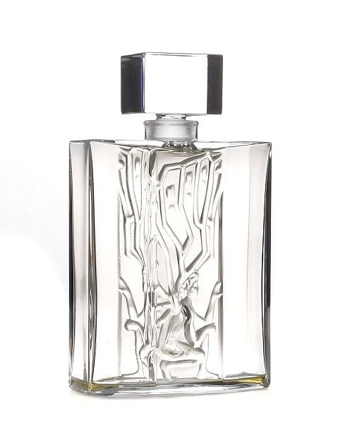 """Lalique (French, founded 1888). Lalique Pour Homme """"Icare (Icarus)"""", eau de parfum limited edition Flacon Collection men's cologne bottle, circa 2006. An art glass men's eau de parfum bottle surmounted by a rectangular glass stopper, the elongated octagonal flacon decorated with an frosted and molded depiction of Icarus, son of Daedalus in Greek mythology. Bottle etched on bottom edge of side panel with """"A555"""", opposite side with """"Lalique France"""". Overall approximate height 6.8"""", width 4""""…"""