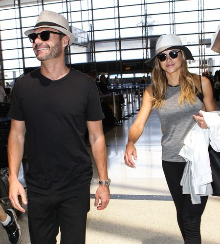 Ryan Seacrest and his girlfriend, Hilary Cruz, were all smiles as they arrived at LAX airport on Sunday.