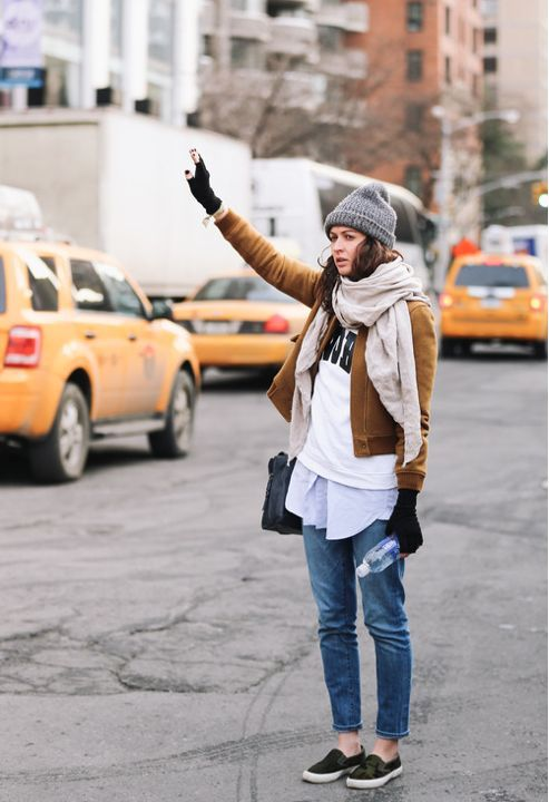 Wear a brown suede bomber jacket with blue jeans for a standout ensemble. Black slip-on sneakers are a great choice to complete the look.  Shop this look for $118:  http://lookastic.com/women/looks/beanie-slip-on-sneakers-jeans-gloves-crossbody-bag-dress-shirt-crew-neck-sweater-scarf-bomber-jacket/6856  — Grey Beanie  — Black Slip-on Sneakers  — Blue Jeans  — Black Wool Gloves  — Black Leather Crossbody Bag  — Light Blue Dress Shirt  — White and Black Print Crew-neck Sweater  — Beige Scarf…