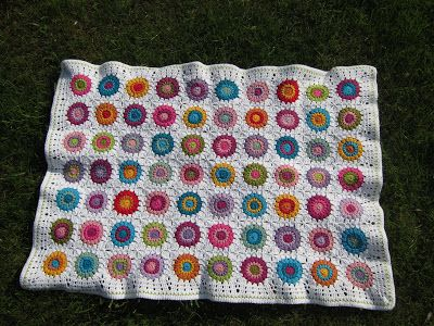 "Baby blanket made up of cirkels from the ""sunburst"" granny pattern"