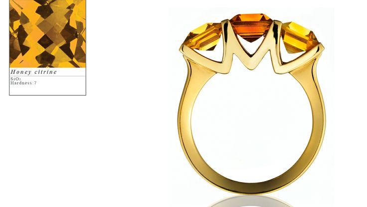 Simon Pure's 18ct yellow gold Encore ring set with one central emerald cut madeira citrine and two emerald cut honey citrines.