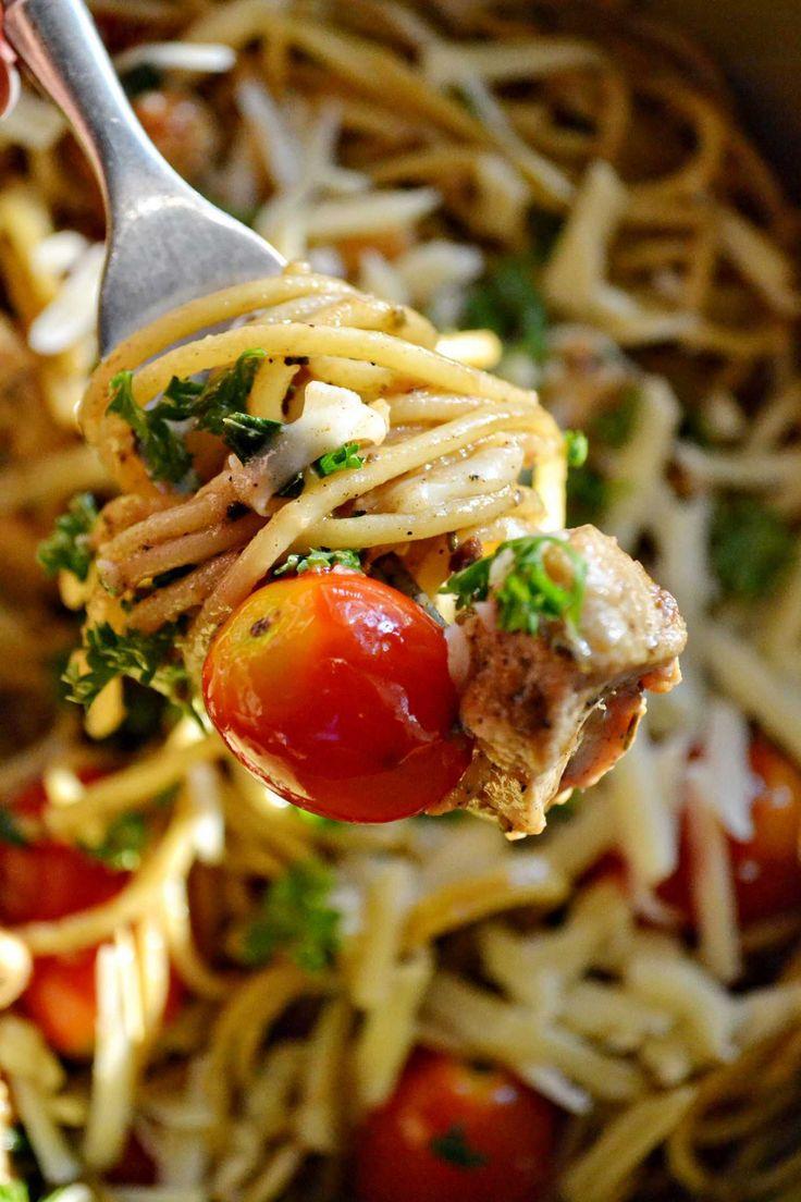 Summer spaghetti - whole cherry tomatoes, lemon marinated chicken, and garlic.