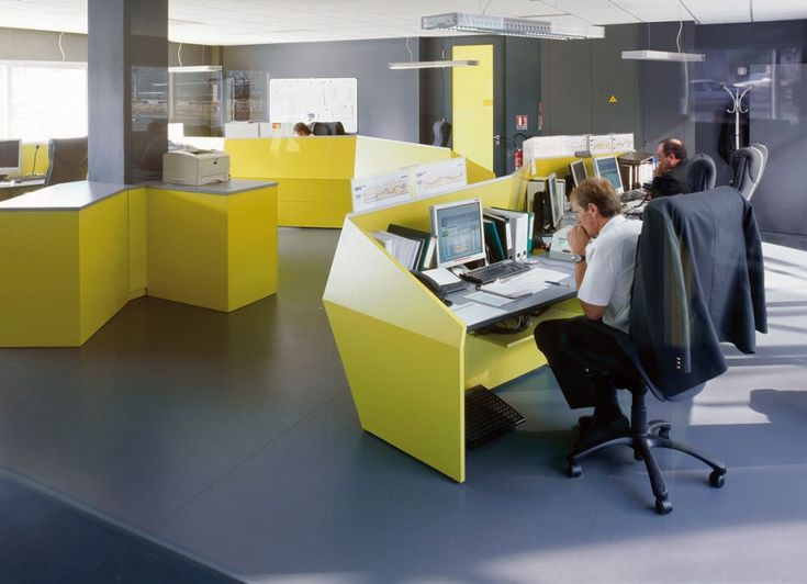 Office interior designs with color block theme yellow desk grey floor black wall wide windows