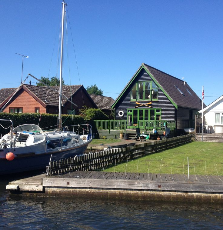 Green Lodge on bank of River Bure Norfolk Broads as you approach Hoveton and Wroxham Villages.