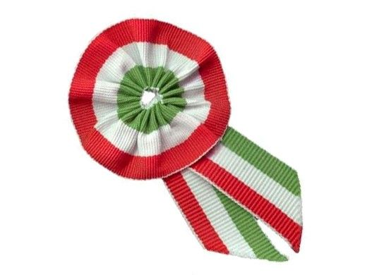 This little so called Cockade is representing the Hungarian flag: starting from the top red-white-green (don't mistake it with the Italian - starting from the right - green-white-red version, we Hungarians are pretty pissed if you do so). We wear this little thing on our dress on the left side of our chest (above our heart) on national holidays, mostly on the 15th of March, when we remember the revolution of 1848. Wearing the cockade is meant to symbolize the national convergence.