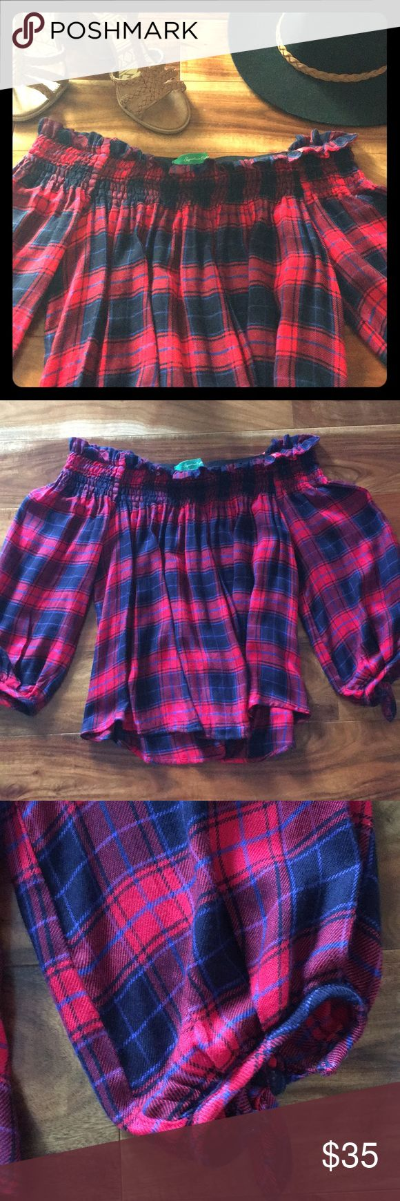 Vici Collection plaid off the shoulder top In great condition only worn twice! From vici collection a perfect piece for fall! Very stretchy elastic top with ruffles. 3/4 sleeves with adjustable ties as shown. Bold red navy blue and black color checkered print. Vici Collection Tops Blouses