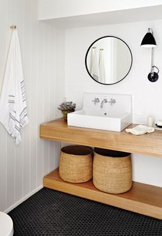 especially love the sconce and contrast in this bathroom
