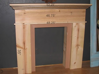 DIY fireplace mantle, maybe I we could build this? Would have to find a non-permanent way to attach to the wall but still keep it from falling over... hmmm
