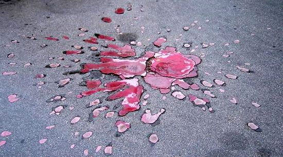 Sarajevo Roses - mortar shell explosions in concrete filled with red resin in honour of those killed in the Bosnian War