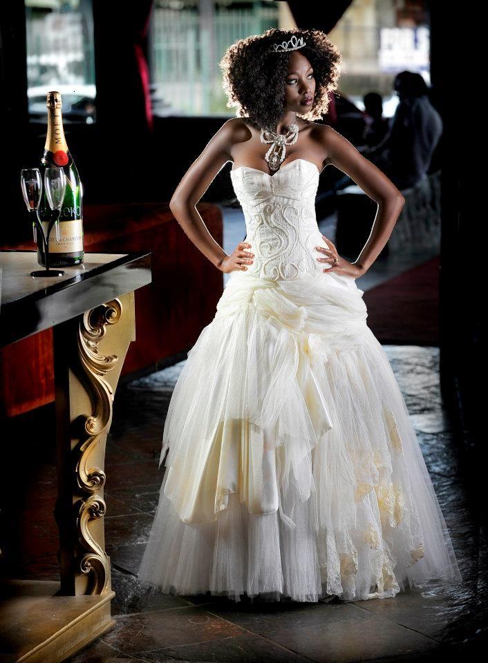 Designer: Yvette van den Berg for Yvi Berg; Photographer: Chris Coetzee; Model: Naomi Bogopa; Couture; Wedding dress; Ivory gown; Bridal Gown; African Model; Queen; Majestic; Dramatic; Voluminous; Silhoutte; 2015; South African; Fashion Design