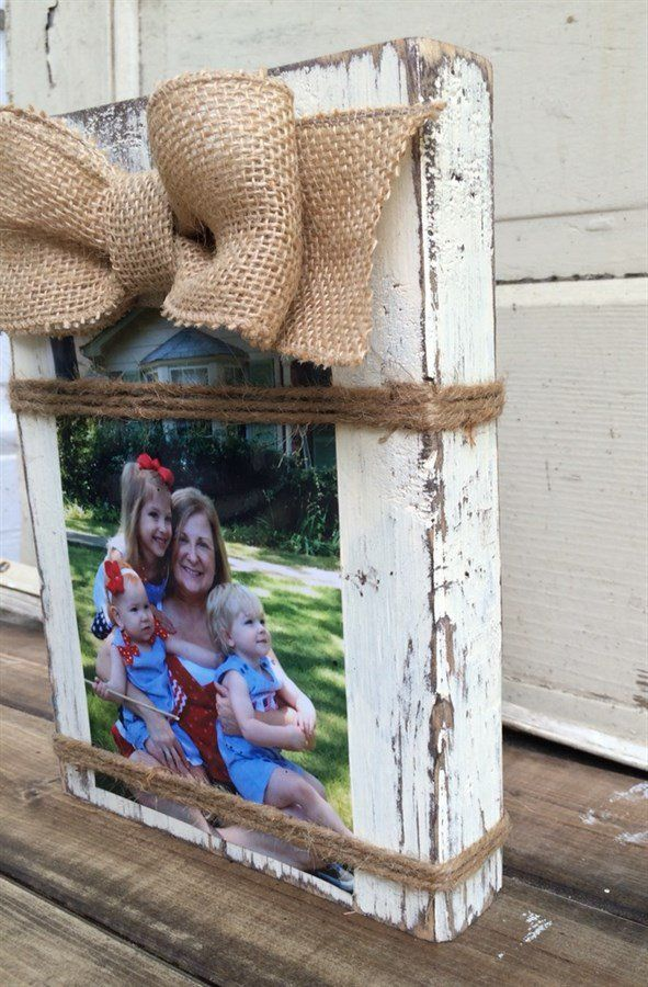 "Adorable Wood Block Picture Frame! Frame will hold a 4x6 or 5x7 Vertical photo.*Frames Are Distressed To Give Them A Rustic Look and Burlap Bow Adds The Perfect Touch Of Southern Farmhouse Charm! *Twine Wrapped Around The Frame Holds The Photo In Place.*Frames Stand Alone (no dowel on the back).*Real Wood That Is Hand Painted & Distressed. *Overall Frame Size:  9.5"" Tall By 7"" Wide By 1.5"" Deep(All Sizes Are Approximate) *A Foam Mounting Square is included for additional ..."