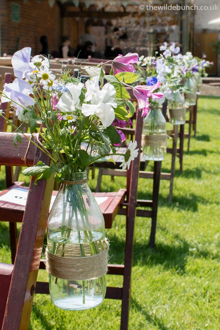 Wedding garden flowers - Outdoor Summer Aisle Flowers Rustic Glass Bottles With Hessian Twine Filled With Country Cottage Garden