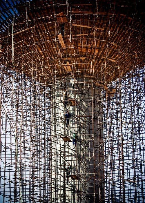 Scaffolding is a temporary structure used to support people and material in the construction or repair of buildings and other large structures. It is usually a modular system of metal pipes or tubes, although it can be from other materials. Bamboo is frequently used in Asia, such as Hong Kong.