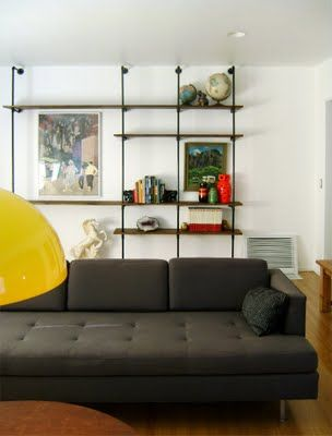 Create a little industrial style with piped-in shelving.