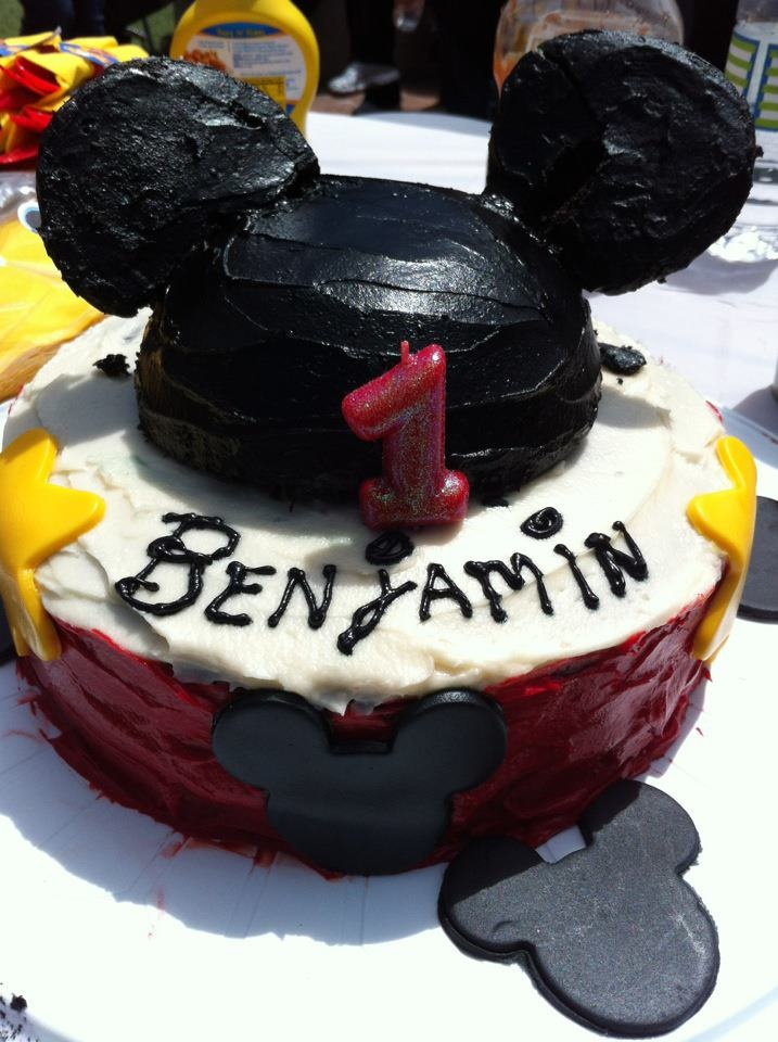 Mickey Mouse birthday cake.  Chocolate layers, with dulce de leche in between.   Buttercream frosting on outside of cake.