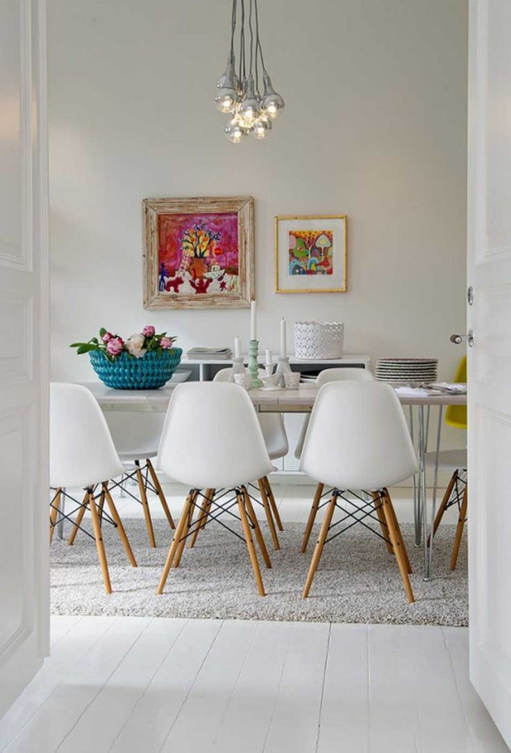 Beautiful White Themed Dining Room For Small Houses Design With Contemporary Dining Table Idea And Adorable White Feather Carpet Design Also Lovely Hanging Lamps Ideas