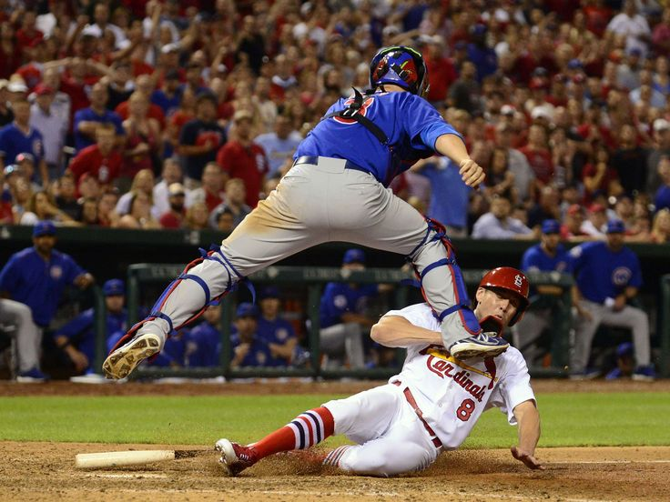 St. Louis Cardinals center fielder Peter Bourjos (8) scores the game-winning run as he collides with Chicago Cubs catcher David Ross (3) during the 10th inning at Busch Stadium.  Jeff Curry, USA TODAY Sports