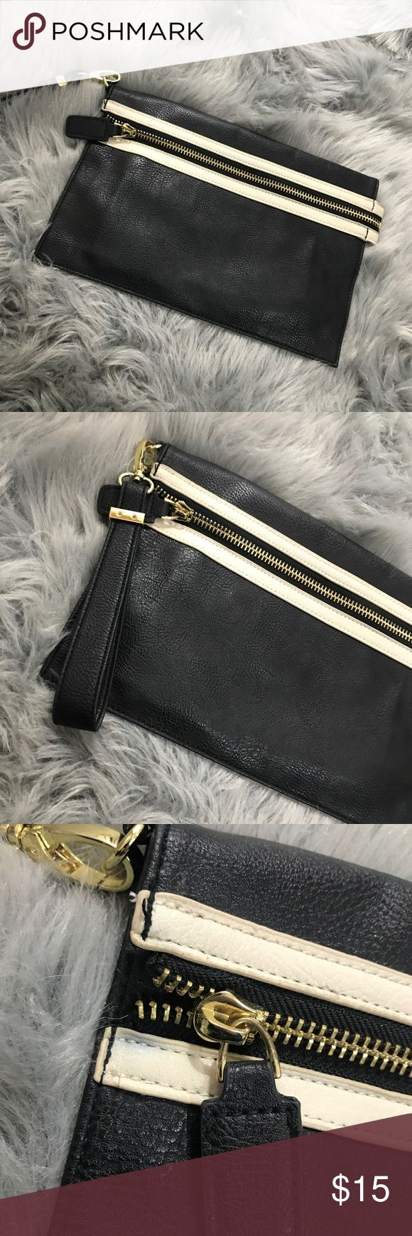 """Big Buddha clutch Brand is Bug Buddha. It is 12""""x8"""" with a 7"""" detachable handle. Only been used a few times. Does have small blue staining on the left side start of the zipper. (Shown in the picture). Big Buddha Bags Clutches & Wristlets"""
