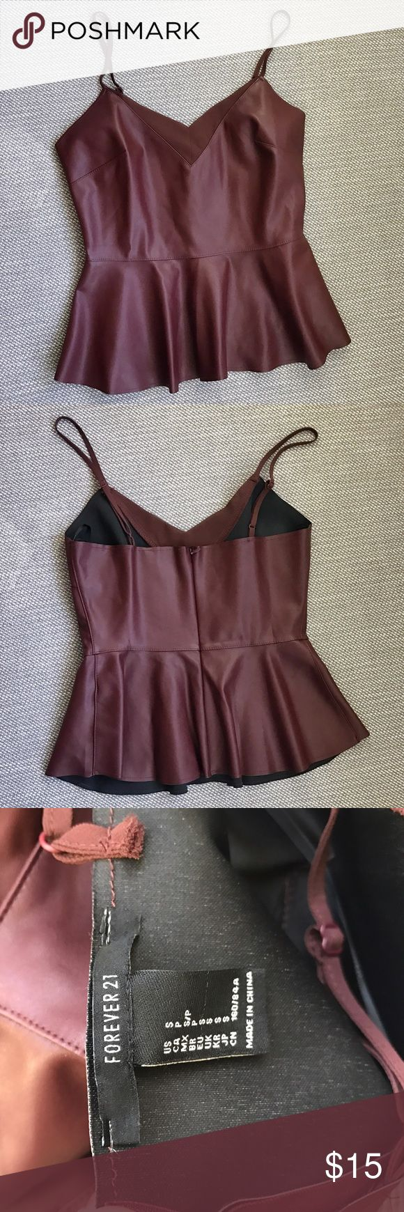 Maroon leather peplum top Faux leather maroon peplum top from Forever 21. Worn once. Very flattering and looks awesome with black pants and heels! Forever 21 Tops Tank Tops