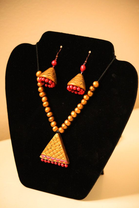 Gold with hint of Metallic Garnet Red Necklace with by Bagoholics, $50.00