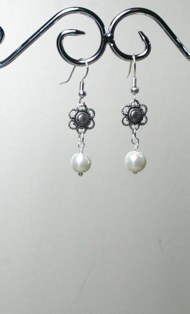 Faux white pearl earrings with flower  €5.00  www.facebook.com/Supposejewellery