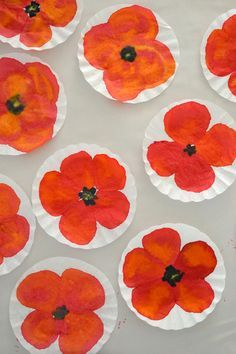 Painting poppies on to coffee filter paper is a great (very quick) activity to do with younger children to commemorate Remembrance Day.
