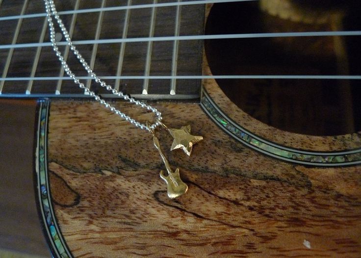 """Rockstar """"What I want to be"""" Necklace in brass by Slashpile Designs. Hand carved guitar and star charms are cast in brass and hang on an 18"""" sterling silver ball chain."""