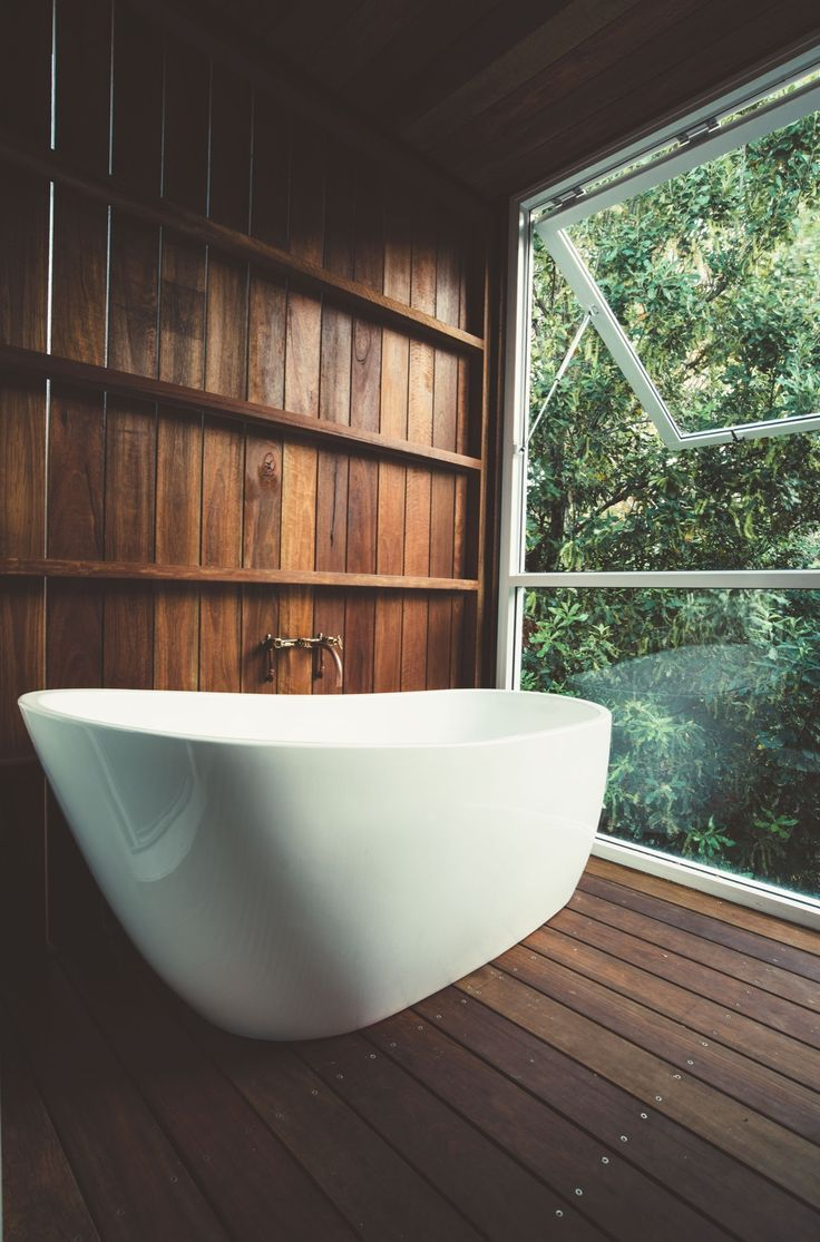 Bathtub in a tranquil wooden bathroom of a renovated 70s modernist beach house with a view of the subtropical rainforest of the Shire of Noosa, Sunshine Coast, Queensland, Australia [1319×2000]