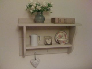 'Jorje'   by www.meadow-made-vintage.co.uk.      This has a multitude of uses... from kitchens, hallways to a bedroom. The combination of hooks with the shelves makes 'Jorje' extremely versatile.