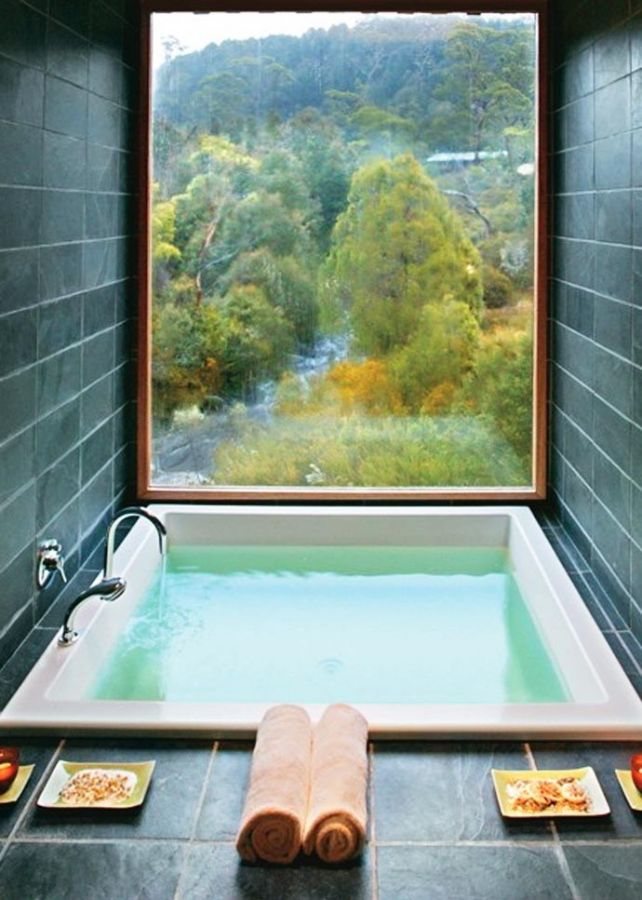 "How's this for an amazing bath tub? Deep, luxurious and with a view to die for, I would never want to get out. How about you? Check out collection of bathroom inspiration in our ""Bathroom Ideas"" album on our site at http://theownerbuildernetwork.co/ideas-for-your-rooms/bathrooms-gallery/bathrooms/ Let us know what you think of it by writing your opinions below."