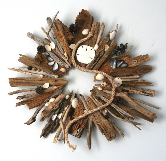 Hand crafted driftwood wreath with sea glass, barnacles, natural sea shells and sand dollars found along the coast of Maine. Browse driftwood crafts on Completely Coastal: http://www.completely-coastal.com/search/label/Driftwood%20Crafts