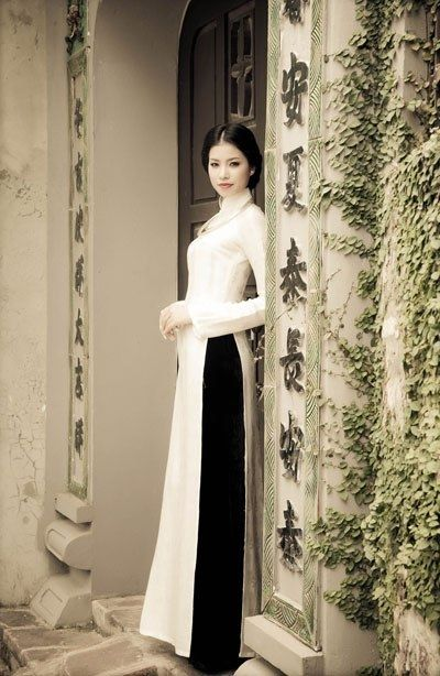 white ao dai with black pants