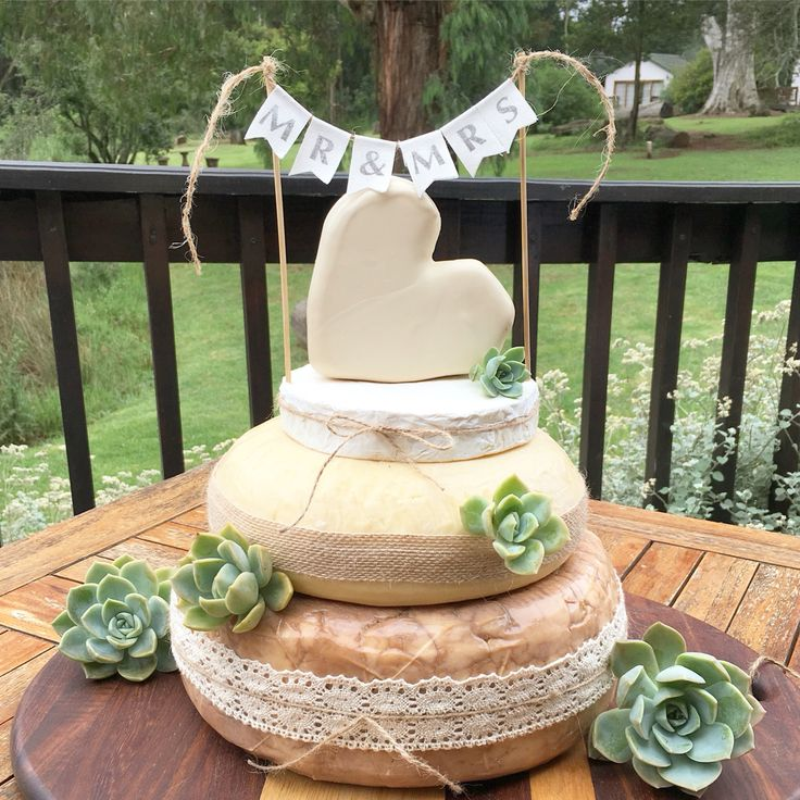 Cheese wedding cake with mini bunting - at CranfordCountryLodge