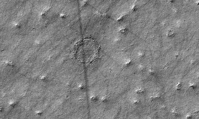 Nasa image reveals bizarre looking crater on the red planet's surface