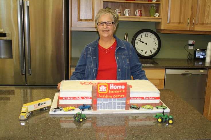 Stella Sware and the cake she made for the grand opening