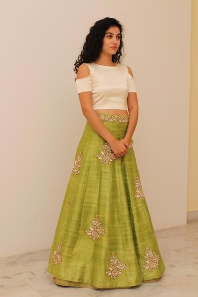 DETAILS. Beige crop top with green embroidered lehenga.  DELIVERY. Delivery will require approximately 4 weeks as the product is customised. Once your order is