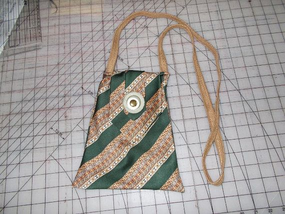 PDF pattern for a purse made from just ONE necktie. This is a great memory item. When the question comes up What should we do with all of Dads or Grandpas old neckties? This is the perfect solution. Let us make a memory. The purse can vary in size to carry only a cell phone to a large