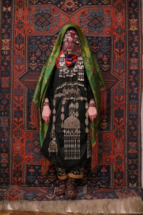 Avar woman (Caucasus), wedding traditional costume. Ethnic groups living in the Russian republic of Dagestan, village Rugudja, tribal caucasian rugs, silver jewellery.