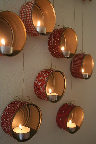 Decorated tins with tea lights, great out door decor!!  Country style wall candle holders