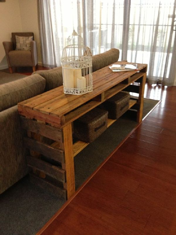 We crafted this useful wooden pallet sofa table with very simple technique, four legs and a top.