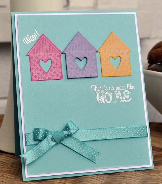 handmade card from Inky Fingers ... clean and simple ... turquoise base ... three adorable die cut houses with hearts punched out ... luv the bright color combo ,.., one silky ribbon ,,, delightful card! ... Papertrey Ink