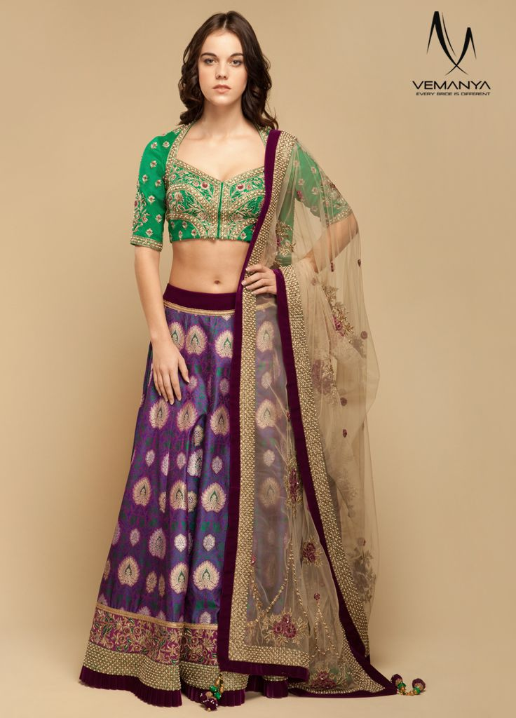 Embroidered Royal Flush Lehenga Rich traditional royal flush lehenga in banarasi weave for your mehendi occasion. A short embroidered dupion silk calypso green choli with a high back, short sleeves and sweetheart neck exude elegance. The exotic colours and the resham, gold, pearl, dabka, sequin embellishments give this ensemble a regal touch. Look like a diva with a contrasting golden mist tulle dupatta.