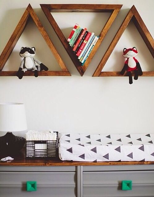Triangles. Fun for a kids room. I'd paint them white or get a lighter stain...