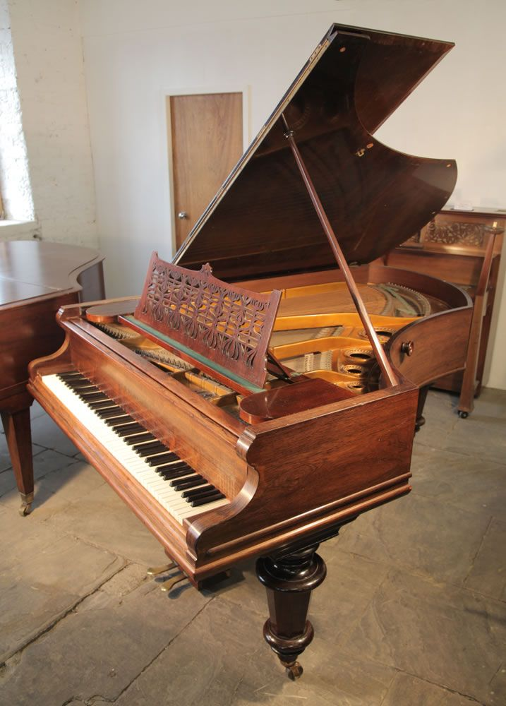 A 1896,  Bechstein Model B grand piano with a polished, rosewood case and turned legs at Besbrode Pianos