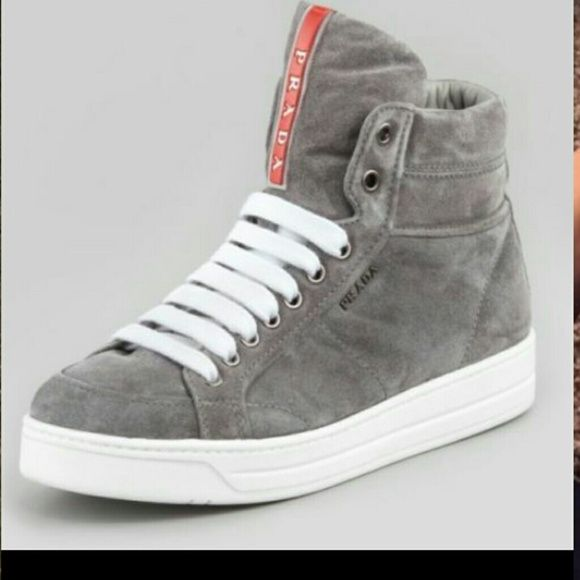 Prada Gray logo suede gym/ sneaker wedge I wear a 7. These fit with extra room. Def a 7 or 71/2. Great shape! Make a reasonable offer and they are yours!! Originally $600. Shoes and suede in great condition.  Stylish with jeans or jeggins. Definitely a must have for winter. Prada Shoes Wedges